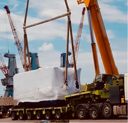 Shipment lifted by crane